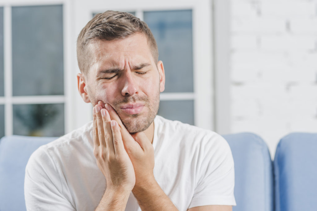 A man suffering from toothache